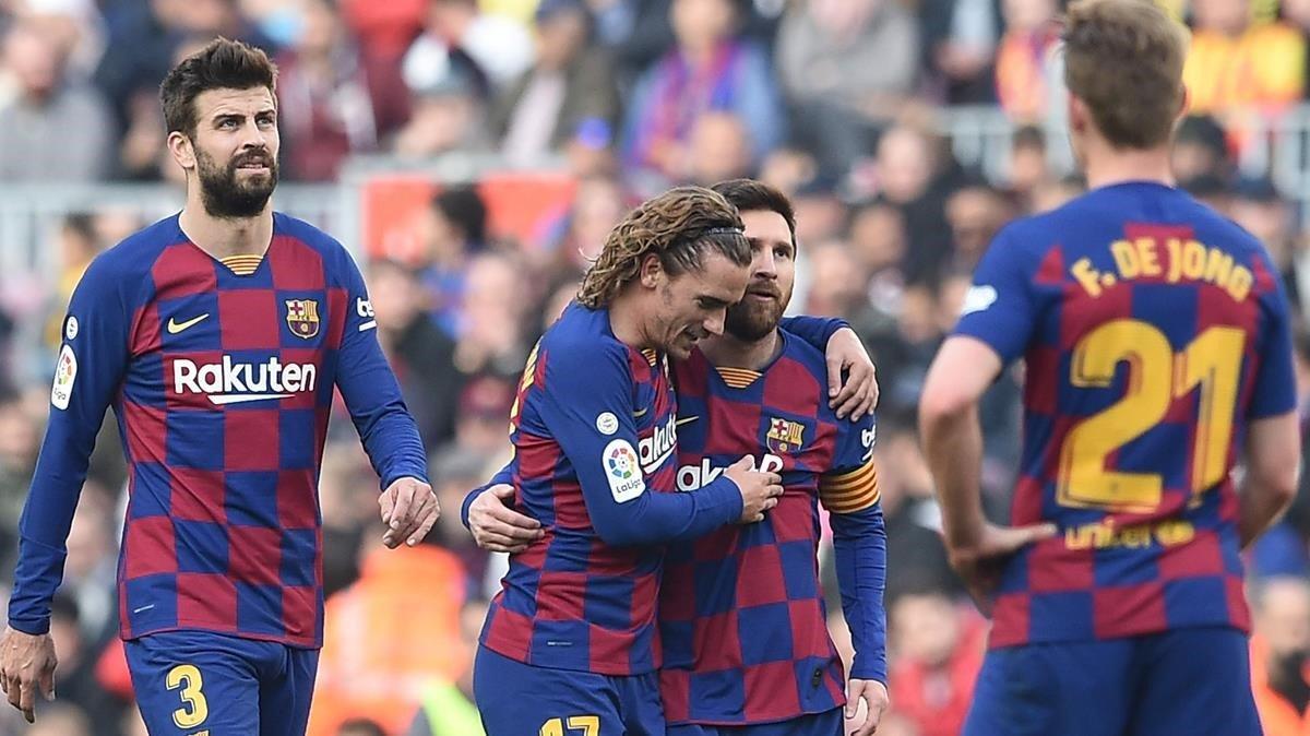Griezmann celebra con Messi su gol ante el Getafe.