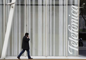 A man walks past a Telefonica building in Barcelona Spain February 26 2016 REUTERS Albert Gea