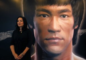 Shannon Lee daughter of the late Kung Fu legend Bruce Lee poses in front of a portrait of her father at the Hong Kong Heritage Museum before the start of a five-year exhibition on Lee July 18 2013 Late kung fu superstar Bruce Lee may be an international icon but he is still not the complete local hero in Hong Kong Fans are marking his death 40 years ago this weekend with art gallery shows exhibitions and even street graffiti but some people are urging Hong Kong s government to do more to honour the former British colony s biggest star REUTERS Bobby Yip CHINA - Tags ENTERTAINMENT ANNIVERSARY