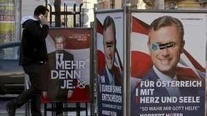 zentauroepp36381472 a man walks between election posters of alexander van der b161124121906