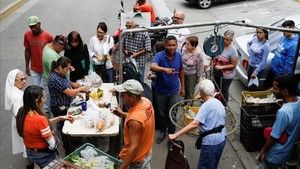 mbenach40933274 people queue to pay for their fruits and vegetables at a str171113185631
