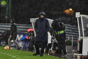 FC Barcelonas head manager Ernesto Valverde protects himself from the rain during the Spanish La Liga soccer match between Barcelona and Real Sociedad, at Anoeta stadium, in San Sebastian, northern Spain, Sunday, Jan.14, 2018. (AP Photo/Alvaro Barrientos)