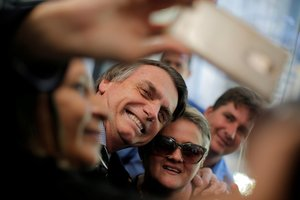 FILE PHOTO Presidential candidate Jair Bolsonaro poses for picture at the National Congress in Brasilia Brazil September 4 2018 REUTERS Adriano Machado File Photo