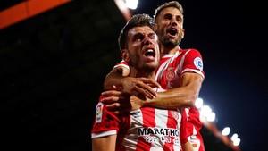 Alcalá celebra su gol al Celta junto a Stuani.