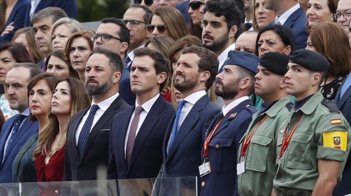 Santiago Abascal, de Vox; Albert Rivera, de Ciudadanos, y Pablo Casado, del PP, en el desfile del 12 de octubre en Madrid.