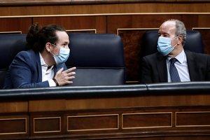 El vicepresidente segundo, Pablo Iglesias, y el ministro de Justicia, el pasado 21 de octubre, durante el debate de la moción de censura de Vox en el Congreso.