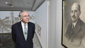 Isidre Fainé, junta a un retrato de Moragas.