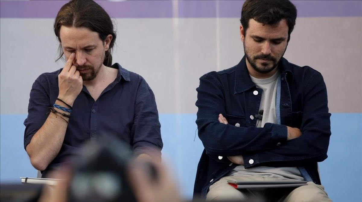 Pablo Iglesias y Alberto Garzón, durante el mitin de cierre de campaña de Unidos Podemos en Madrid.