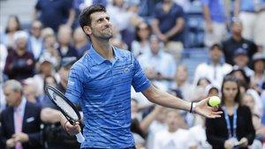 Djokovic celebra su victoria ante Carballés en el Abierto de Estados Unidos, este lunes.