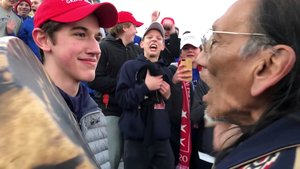 FILE PHOTO: Nicholas Sandmann, 16, a student from Covington Catholic High School stands in front of Native American activist Nathan Phillips in Washington, U.S., in this still image from a January 18, 2019 video by Kaya Taitano. Kaya Taitano/Social Media/via REUTERS/File Photo ATTENTION EDITORS - THIS IMAGE HAS BEEN SUPPLIED BY A THIRD PARTY. MANDATORY CREDIT. NO RESALES. NO ARCHIVE. - RC1618EDA640