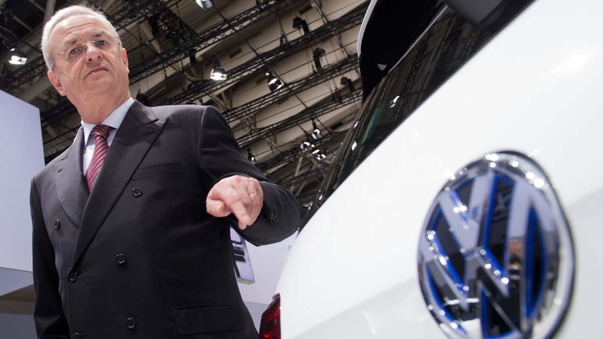 FILE In this May 13, 2014 file picture then Volkswagen CEO , Martin Winterkorn, stands next to a VW car at the annual shareholder meeting in Hannover, Germany. German prosecutors said Monday June 20, 2016 they have opened an investigation of former Volkswagen CEO Martin Winterkorn on allegations of market manipulation in connection with the companys scandal over cars rigged to cheat on U.S. diesel emissions tests. ( Julian Stratenschulte/dpa via AP,file)