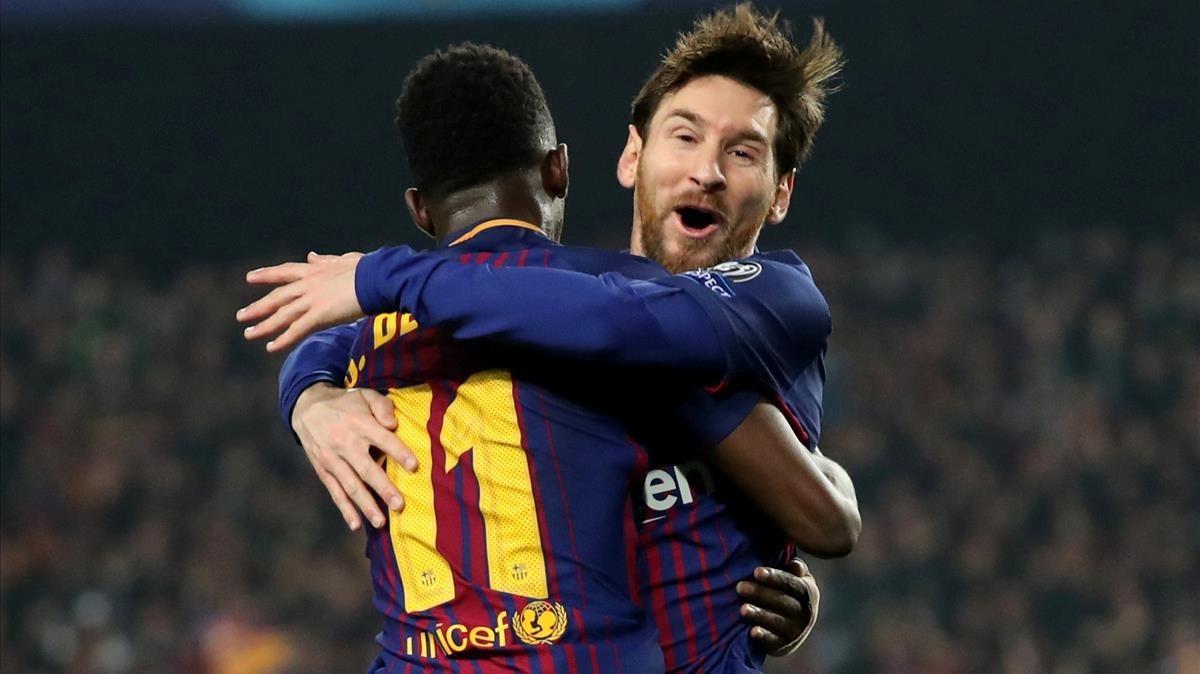 Messi, abrazando a Dembélé.