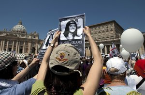 Demonstrators hold pictures of Emanuela Orlandi reading  march for truth and justice for Emanuela  during Pope Benedict XVI s Regina Coeli prayer in St  Peter s square  at the Vatican  The Vatican says human bones were found during renovation work near its embassy to Italy  reviving speculation once again about the fate of Orlandi  the 15-year-old daughter of a Vatican employee who disappeared in 1983   AP Photo Andrew Medichini  File