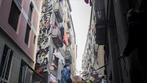 Uno de los murales dedicados a la rumba catalana en la calle de la Cera.