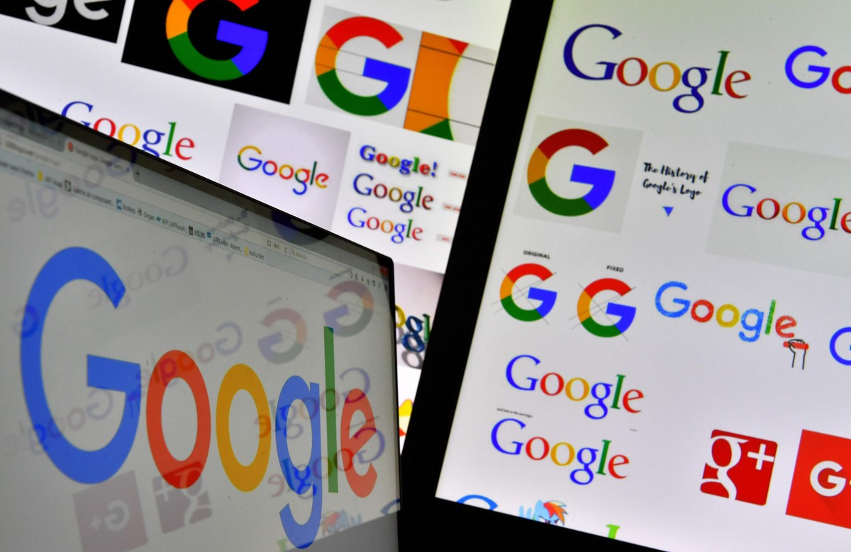 FILES This file photo taken on November 20 2017 shows shows logos of US technology company Google displayed on computer screens Google is accused of illegally collecting data belonging to more than five million UK iPhone users in a mass legal action launched on November 30 2017 A campaign group dubbed Google You Owe us says the tech giant owes consumers trust fairness and money after unlawfully placing cookies on mobile phones between 2011 and 2012 AFP PHOTO LOIC VENANCE