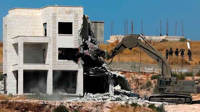 Israel derriba decenas de viviendas palestinas bajo jurisdiccion de la ANP.