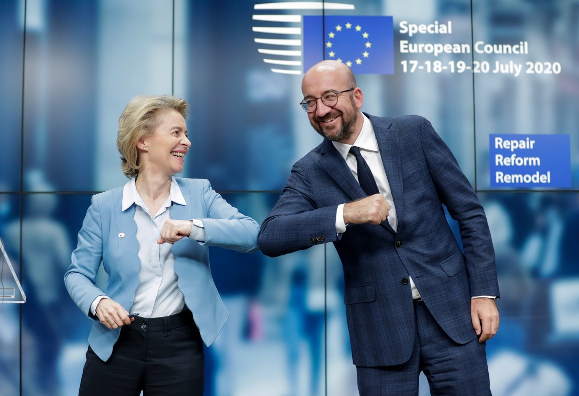 European Council President Charles Michel and European Commission President Ursula Von Der Leyen do an elbow bump at the end of a news conference following a four-day European summit at the European Council in Brussels, Belgium, July 21, 2020. Stephanie Lecocq/Pool via REUTERS