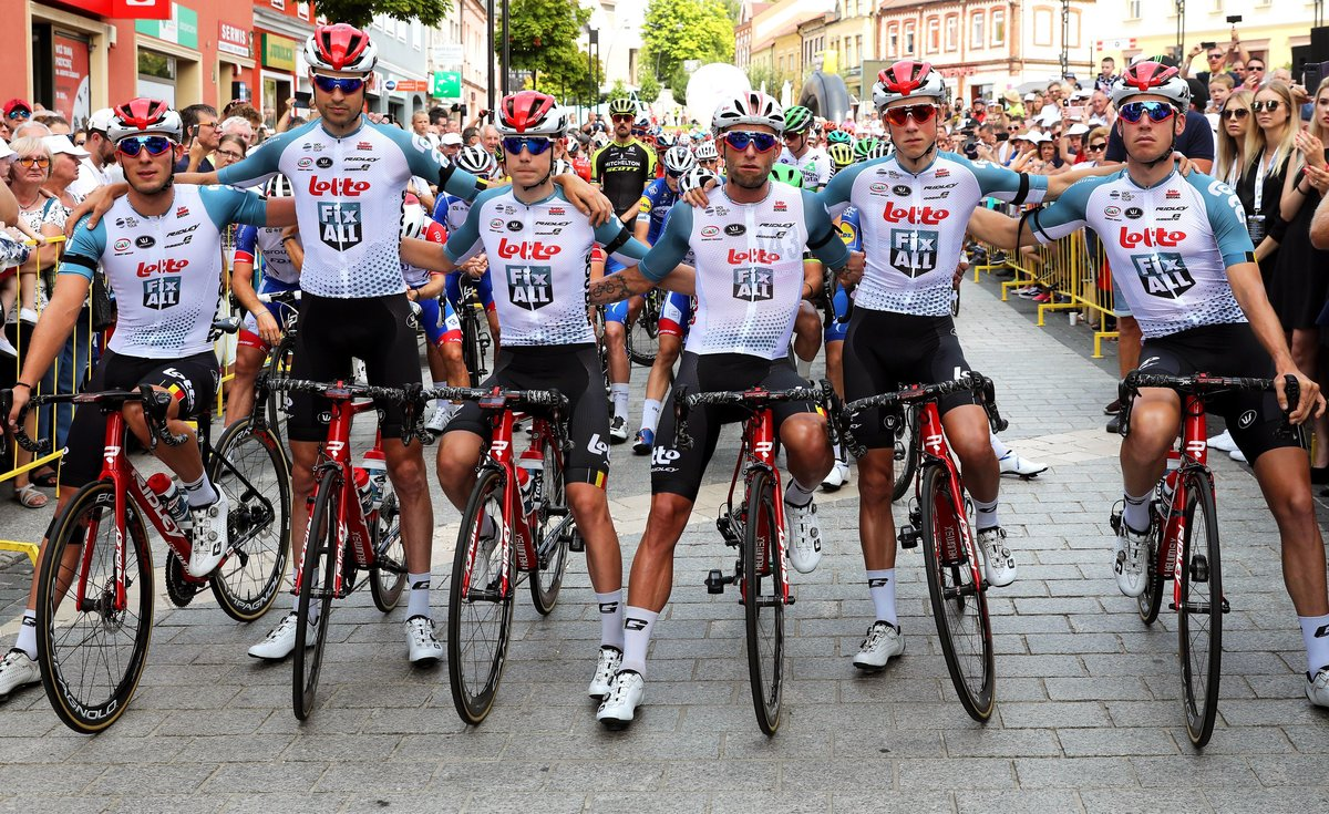 Jaworzno (Poland), 06/08/2019.- Riders of the Lotto Soudal team hold a minute of silence for their Belgian teammate Bjorg Lambrecht at the start of the fourth stage of the Tour de Pologne cycling race over 133.7km from Jaworzno to Kocierz, Poland, 06 August 2019. Bjorg Lambrecht, aged 22, of the Lotto Soudal team, crashed into a concrete culvert on the road during the third stage of the race. He was resuscitated and taken to hospital in Rybnik, where he died of his injuries. The organisers shortened the fourth stage by a 38.5km loop around Kocierz. The stage was also neutralized to pay respects to Lambrecht. (Ciclismo, Polonia) EFE/EPA/ANDRZEJ GRYGIEL POLAND OUT