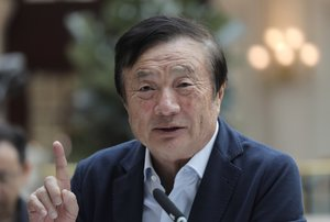 Ren Zhengfei  founder and CEO of Huawei  gestures during a round table meeting with the media in Shenzhen city  south China s Guangdong province The founder of network gear and smart phone supplier Huawei Technologies said the tech giant would reject requests from the Chinese government to disclose confidential information about its customers   AP Photo Vincent Yu