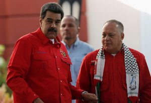 FILE PHOTO Diosdado Cabello President of Venezuela s National Constituent Assembly and Venezuela s President Nicolas Maduro are seen during a meeting of the Sao Paulo Forum in Caracas Venezuela July 28 2019 REUTERS Manaure Quintero - File Photo