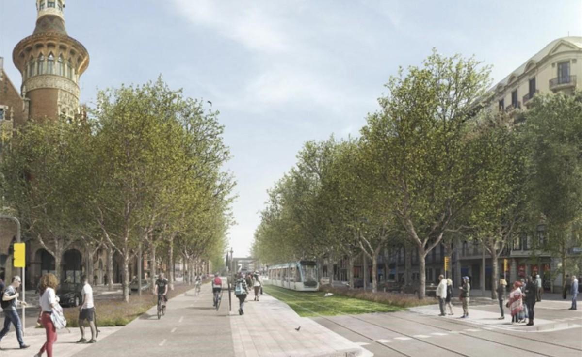 El tranvía por el centro de la calzada junto a las bicis, a su paso por la Casa de les Punxes.