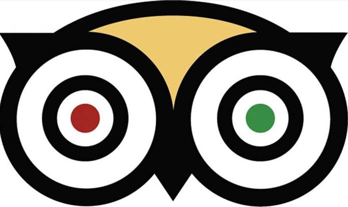 El logo de TripAdvisor, la principal web mundial de opiniones sobre restaurantes y alojamientos.