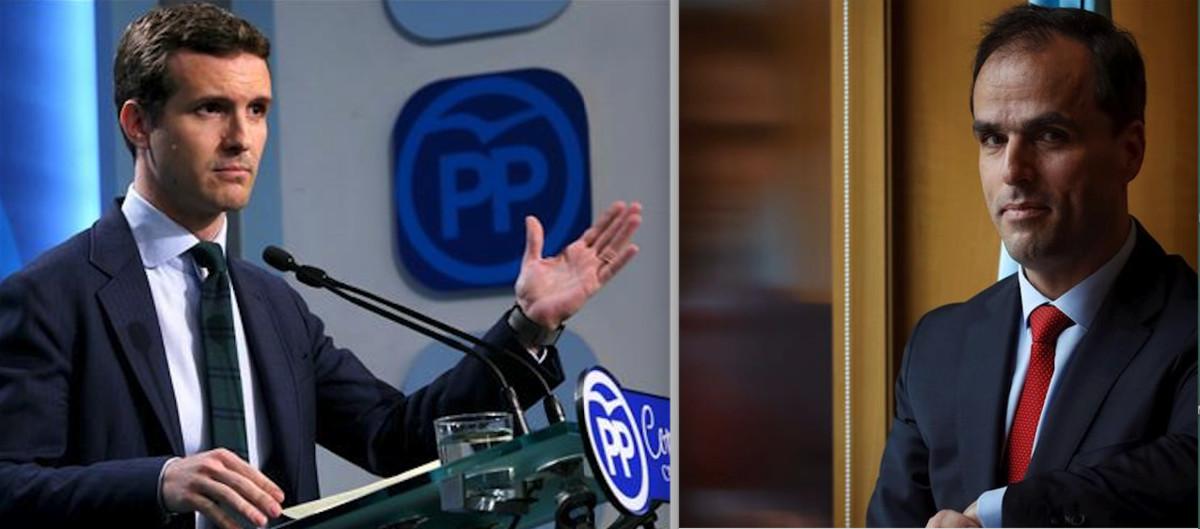El vicesecretario de Comunicación del PP, Pablo Casado, a la izquierda durante una comparecencia pública para negar irregularidades en la obtención de sus títulos universitarios. A la derecha, el rector de la Universidad Rey Juan Carlos, Javier Ramos.