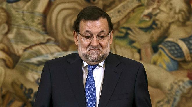 Las muecas de Rajoy al ser preguntado porlos cambios en el Ejecutivo.