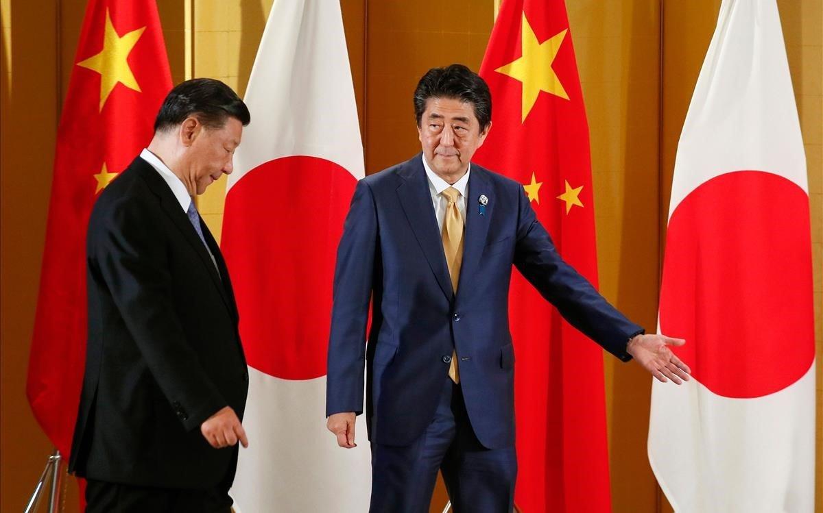 Shinzo Abe recibe a Xi Jinping en Osaka.