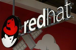 The logo of Red Hat Software is pictured at the Mobile World Congress  MWC   the world s biggest mobile fairin Barcelona. Photo by Pau Barrena   AFP