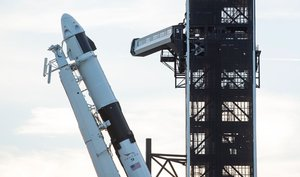 This handout photo released by NASA shows A SpaceX Falcon 9 rocket with the company's Crew Dragon spacecraft onboard as it is raised into a vertical position on the launch pad at Launch Complex 39A as preparations continue for the Demo-1 mission on February 28, 2019 at the Kennedy Space Center in Florida. - The Demo-1 mission will be the first launch of a commercially built and operated American spacecraft and space system designed for humans as part of NASA's Commercial Crew Program. The mission, currently targeted for a 2:49am launch on March 2, will serve as an end-to-end test of the system's capabilities. (Photo by NASA/Joel Kowsky / NASA / AFP) / -----EDITORS NOTE --- RESTRICTED TO EDITORIAL USE - MANDATORY CREDIT AFP PHOTO / NASA / JOEL KOWSKY  - NO MARKETING - NO ADVERTISING CAMPAIGNS - DISTRIBUTED AS A SERVICE TO CLIENTS