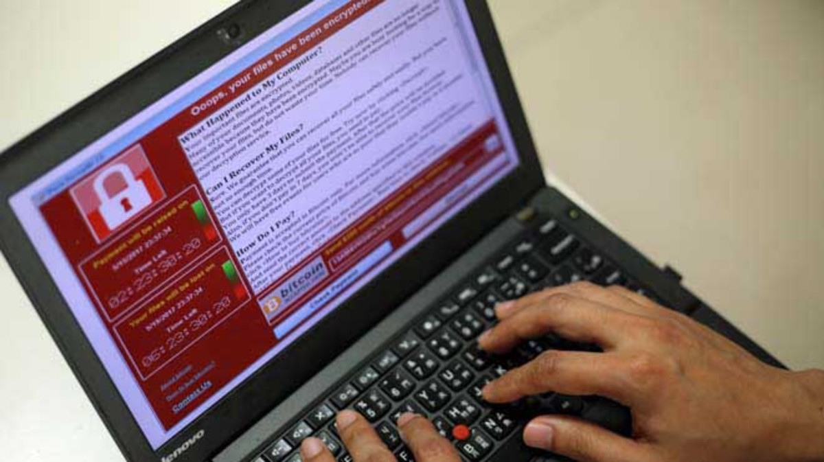 RIT01. Taipei (Taiwan), 12/05/2017.- A programer shows a sample of a ransomware cyberattack on a laptop in Taipei, Taiwan, 13 May, 2017. According to news reports, a 'WannaCry' ransomware cyber attack hits thousands of computers in 99 countries encrypting files from affected computer units and demanding 300 US dollars through bitcoin to decrypt the files. (Atentado, Estados Unidos) EFE/EPA/RITCHIE B. TONGO