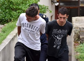 Picture showing two of the five men accused of allegedly raping a 14-year-old girl inside a tent at a campsite in Miramarprovince of Buenos Airesbeing escorted by the police to testify in Mar del Plata400 km south of the Argentine capitalPhoto by Jose SCALZONOTICIAS ARGENTINASAFP