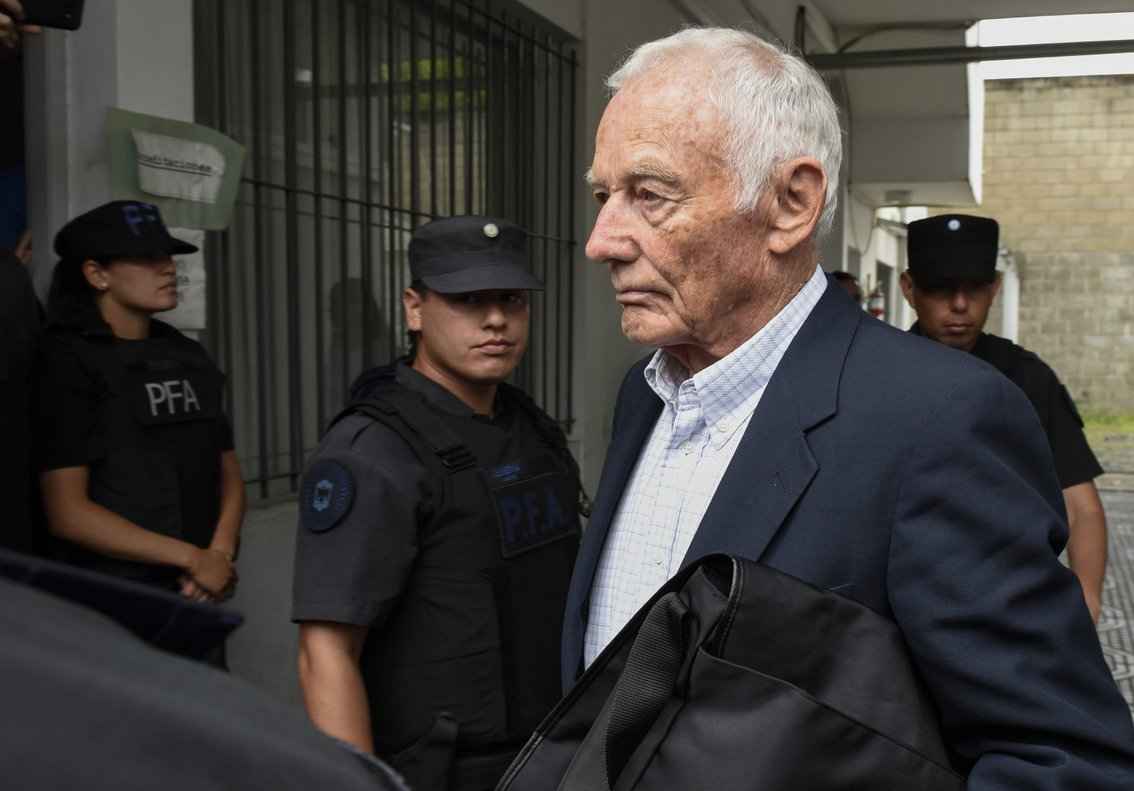 Former Ford Motor Coexecutive Pedro Muller leaves a courthouse after he was sentenced to 10 years for crimes against humanity committed against 24 Argentine union workers during the country s 1976-1983 military dictatorshipin Buenos AiresArgentina.AP Photo Gustavo Garello