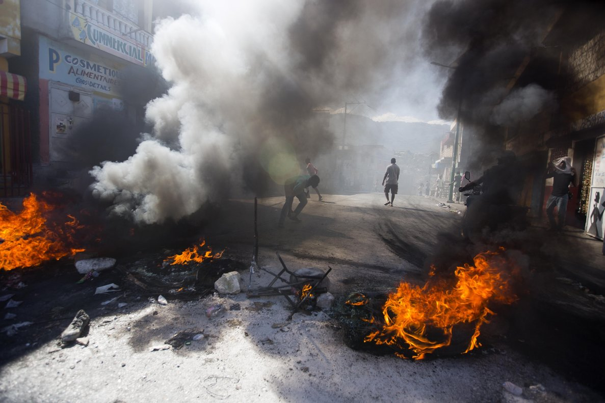 Demonstrators block a road with a burning barricade during a strike that is part of protests demanding to know how Petro Caribe funds have been used by the current and past administrationsin Port-au-PrinceHaiti. Much of the financial support to help Haiti rebuild after the 2010 earthquake comes from Venezuela s Petro Caribe funda 2005 pact that gives suppliers below-market financing for oil and is under the control of the central governmentAP Photo Dieu Nalio Chery