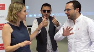 Tania Sánchez, Juan Carlos Monedero y Luis Alegre, en los cursos de verano de El Escorial.