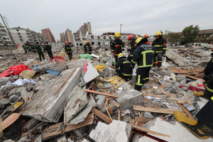 Rescue workers work at the site of a blast in Ningbo
