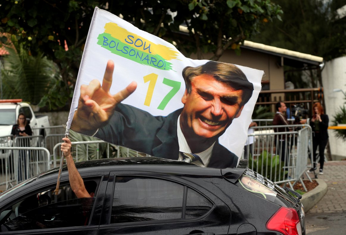 A supporter of Brazils new president-elect, Jair Bolsonaro, celebrates in front of Bolsonaros condominium at Barra da Tijuca neighborhood in Rio de Janeiro, Brazil.REUTERS/Sergio Moraes