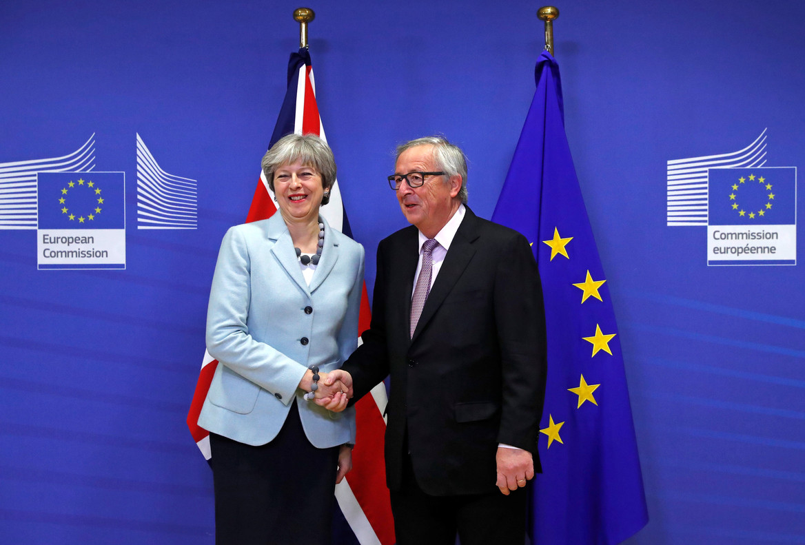 Britain's Prime Minister Theresa May is welcomed by European Commission President Jean-Claude Juncker at the EC headquarters in Brussels, Belgium December 8, 2017. REUTERS/Yves Herman