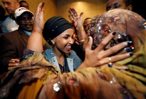 Democratic congressional candidate Ilhan Omar is greeted by her husbandâ¿¿s mother after appearing at her midterm election night party in Minneapolis, Minnesota, U.S. November 6, 2018. REUTERS/Eric Miller TPX IMAGES OF THE DAY