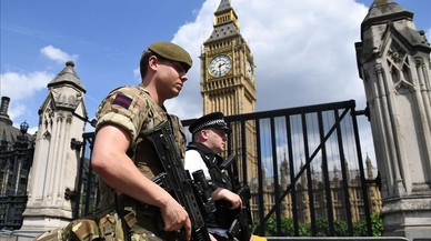 lpedragosa38588932 topshot a british army soldier patrols with an armed polic170524213727