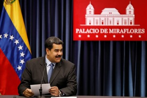Venezuela s President Nicolas Maduro smiles as he talks to the media during a news conference at Miraflores Palace in Caracas Venezuela September 18 2018 REUTERS Marco Bello