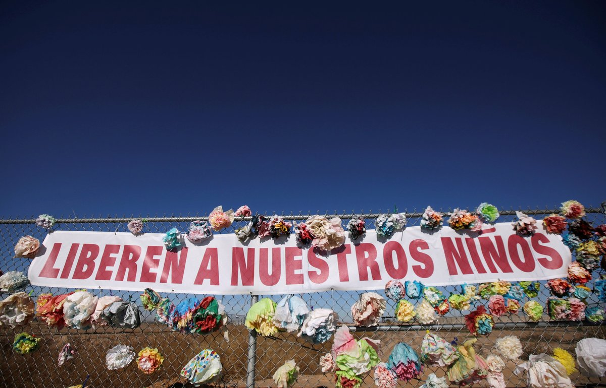 A banner placed by activists hangs from a fence near a tent city in Texas for migrant teens which the U S government on Friday said will be closed next to the Mexican border in Tornillo Texas U S January 12 2019 The banner reads Let our Children go REUTERS Jose Luis Gonzalez