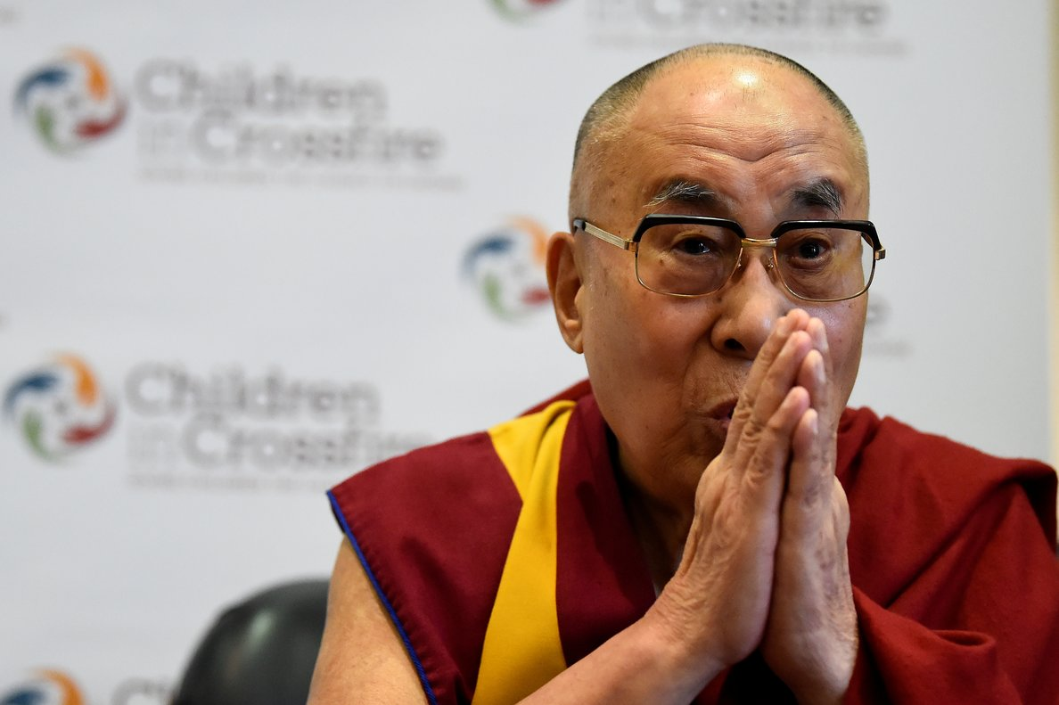FILE PHOTO: Tibetan spiritual leader the Dalai Lama, Patron of Children in Crossfire, gestures during a press conference in Londonderry, Northern Ireland September 11, 2017. REUTERS/Clodagh Kilcoyne/File Photo
