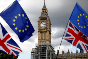 FILE PHOTO: Union Flags and European Union flags fly near the Elizabeth Tower, housing the Big Ben bell, during the anti-Brexit Peoples March for Europe, in Parliament Square in central London, Britain September 9, 2017. REUTERS/Tolga Akmen/File Photo