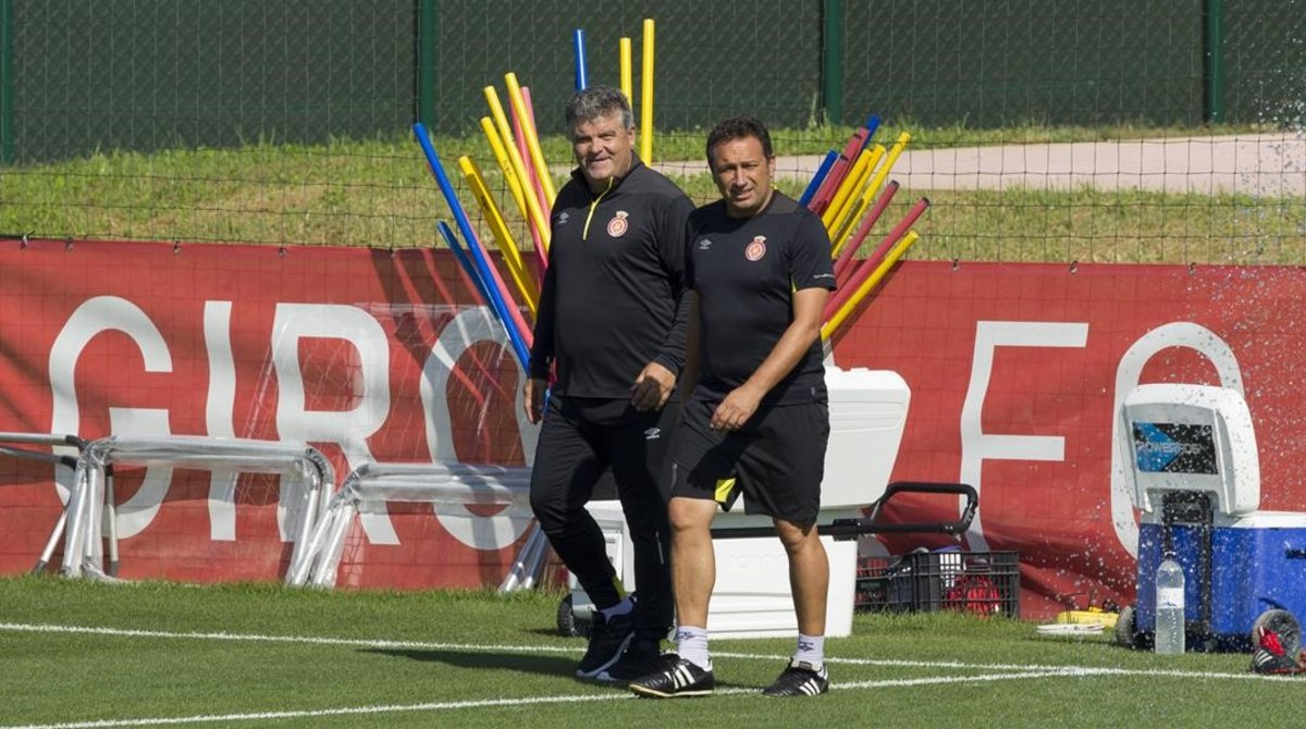 Onésimo y Eusebio, el tándem técnico del Girona, en un entrenamiento.