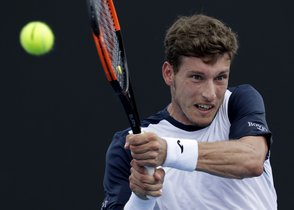 Spains Pablo Carreno Busta makes a backhand return to Ilya Ivashka of Belarus during their second round match at the Australian Open tennis championships in Melbourne, Australia, Thursday, Jan. 17, 2019. (AP Photo/Kin Cheung)