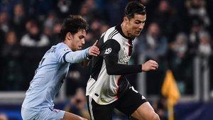 Joao Fleix y Cristiano Ronaldo, en el partido disputado en Turín.