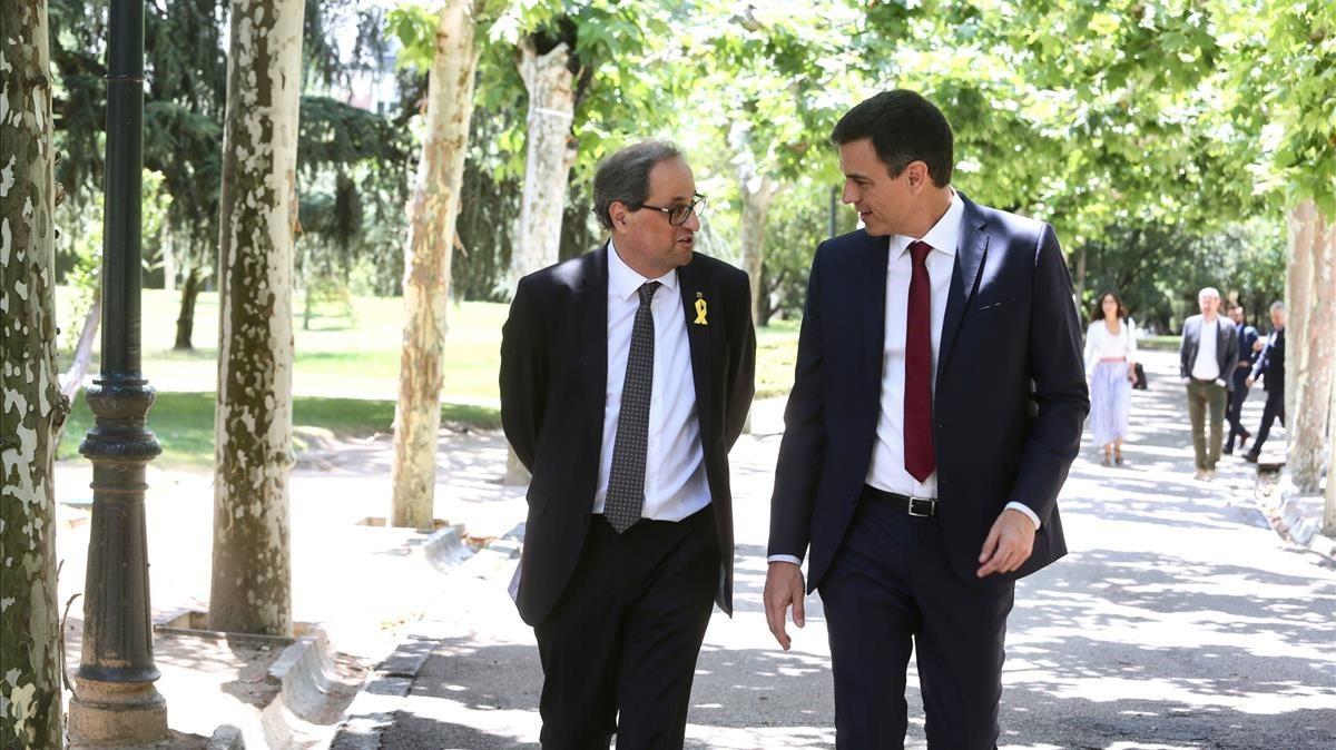 Los presidentes Quim Torra y Pedro Sánchez.