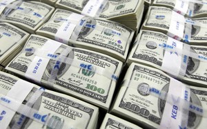 U.S. dollar notes are seen in this picture illustration taken at the Korea Exchange Bank in Seoul